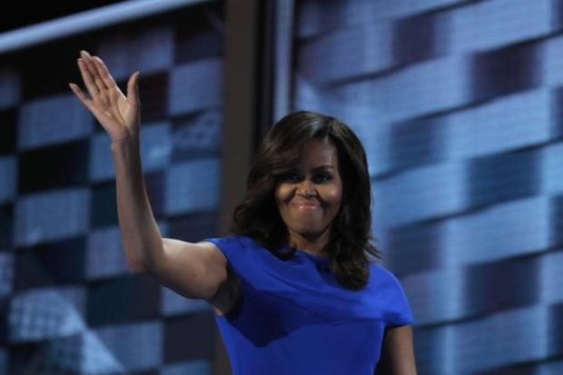 U.S. first lady Michelle Obama waves after speaking during the first session at the Democratic National Convention in Philadelphia